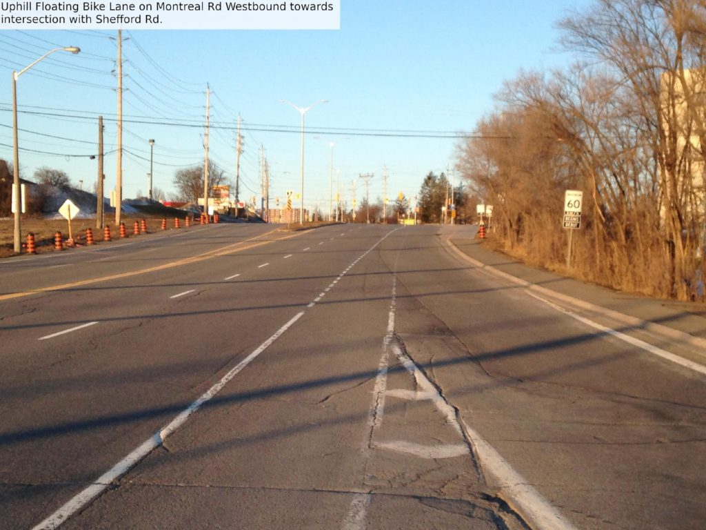 Uphill floating bike lane on Montreal Rd westbound toward intersection with Shefford Rd.